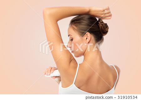 woman with antiperspirant deodorant over white 31910534