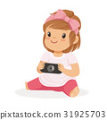 Cute little girl sitting on the floor and playing 31925703