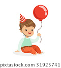 Adorable baby boy wearing a red party hat sitting 31925741