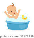 Happy baby taking a bath playing with foam bubbles 31926136