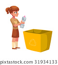 Girl going to throw plastic bottle in a trash bin 31934133