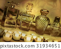 Pearls, and, different, bottles, of, perfume 31934651