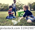 Ecology group of children separate trash for recycle 31942987