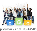 Kids and plastic bottles in a recycle bin 31944505