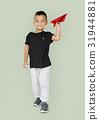Little Boy Holding Paper Plane Studio Portrait 31944881