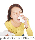 woman with a an allergy sneezing into tissues 31949715