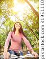 smiling  asian young woman riding bike  31951110