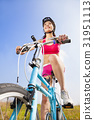 woman biker riding Folding Bicycle  with blue sky  31951113