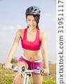 beautiful woman biker riding Folding Bicycle   31951117
