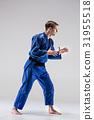 The one judokas fighter posing on gray 31955518