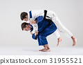 The two judokas fighters fighting men 31955521