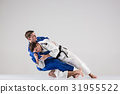 The two judokas fighters fighting men 31955522