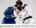The two judokas fighters fighting men 31955523