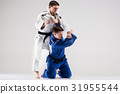 The two judokas fighters fighting men 31955544