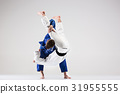 The two judokas fighters fighting men 31955555