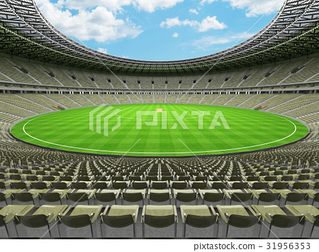 Beautiful cricket stadium with olive green seats 31956353