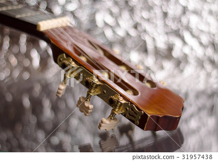 Guitar headstock on silver background 31957438