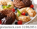Horseshoe biscuits with chocolate and almonds 31962851