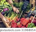 Greengrocer preparing organic fresh agricultural product at farm 31968054