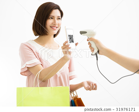 young woman pay by smart phone with qr code 31976171
