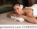 portrait of young beautiful woman in spa 31980050