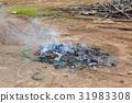 burning garbage with white smoke 31983308