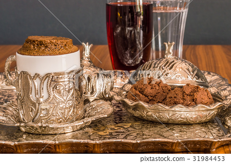 Turkish coffee served with water and cookies 31984453