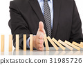 businessman hand stop dominoes continuous toppled 31985726