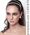 Beautiful model wearing hair wedding accessories 31991876