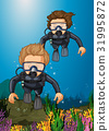 Two divers diving under the ocean 31995872