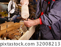 Hands woodcarver while working with the tools 32008213