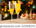 Two glasses of sparkling wine with apricot 32008241