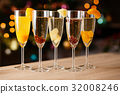 Five glasses of champagne with fruit 32008246