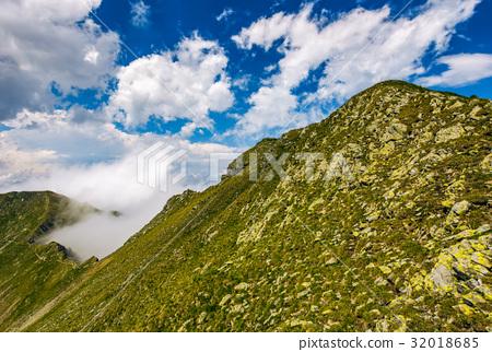 Steep slope on rocky hillside in fog 32018685