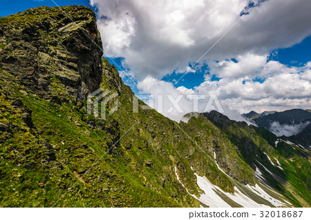 Steep slope on rocky hillside in fog 32018687