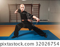 Wushu master training with sword, martial arts 32026754
