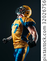 American football player in uniform and helmet 32026756