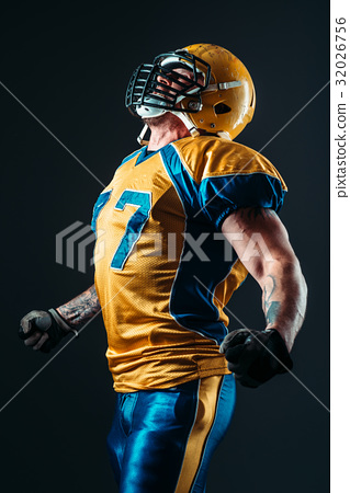 American football player in uniform and helmet 32026756