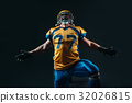American football player in uniform and helmet 32026815