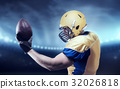 American football player with ball on sport arena 32026818