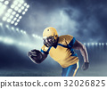 American football player with ball on sport arena 32026825