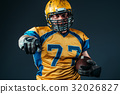 American football player pointing his finger 32026827