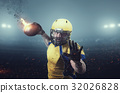 American football player with burning ball 32026828