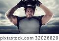 Muscular american football player against dark sky 32026829