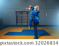 Female wushu fighter with sword in action 32026834