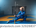 Female wushu fighter with sword in action 32026837