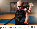 Wushu master with blade in action, martial arts 32026838