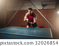 Table tennis, male player with racket and ball 32026854