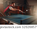Table tennis, man playing game, ball with trace 32026857