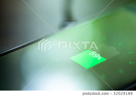 Smartphone charging on a charging pad. Wireless 32029189